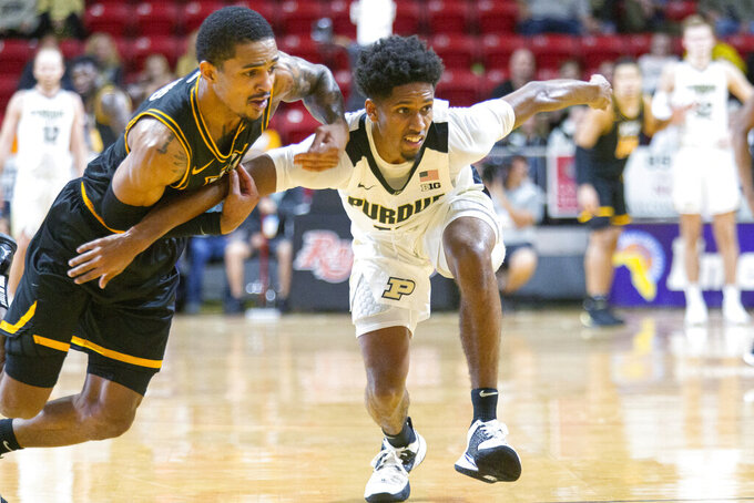 Virginia Commonwealth guard Marcus Evans, left, and Purdue guard Eric Hunter Jr. (2) watch the ball during second half of an NCAA college basketball game at the Emerald Coast Classic in Niceville, Fla., Friday, Nov. 29, 2019. Purdue won 59-56. (AP Photo/Mark Wallheiser)