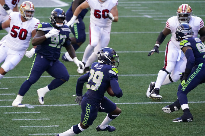 Seattle Seahawks defensive back Jayson Stanley runs with the ball after making an interception against the San Francisco 49ers during the first half of an NFL football game, Sunday, Nov. 1, 2020, in Seattle. (AP Photo/Elaine Thompson)