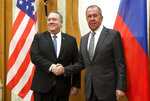 U.S. Secretary of State Mike Pompeo, left, and Russian Foreign Minister Sergey Lavrov pose for a photo prior to their talks in the Black Sea resort city of Sochi, southern Russia, Tuesday, May 14, 2019. Pompeo's first trip to Russia starts Tuesday in Sochi, where he and Russian Foreign Minister Sergey Lavrov are sitting down for talks and then having a joint meeting with President Vladimir Putin. (Russian Foreign Ministry Press Service via AP)