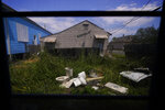In this Sept. 4, 2021, photo, debris is seen in the yard of Lationa Kemp's rental home in the aftermath of Hurricane Ida in the Lower Ninth Ward of New Orleans. (AP Photo/Matt Slocum)