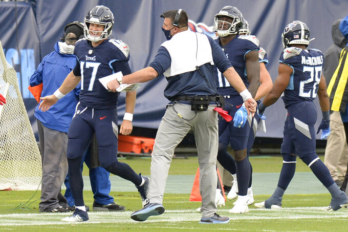 Tennessee Titans head coach Mike Vrabel celebrates with quarterback Ryan Tannehill (17) after a touchdown against the Houston Texans in the first half of an NFL football game Sunday, Oct. 18, 2020, in Nashville, Tenn. (AP Photo/Mark Zaleski)