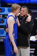 Creighton head coach Greg McDermott talks with Jacob Epperson (41) in the second half of a Sweet 16 game against Gonzaga in the NCAA men's college basketball tournament at Hinkle Fieldhouse in Indianapolis, Sunday, March 28, 2021. (AP Photo/Michael Conroy)