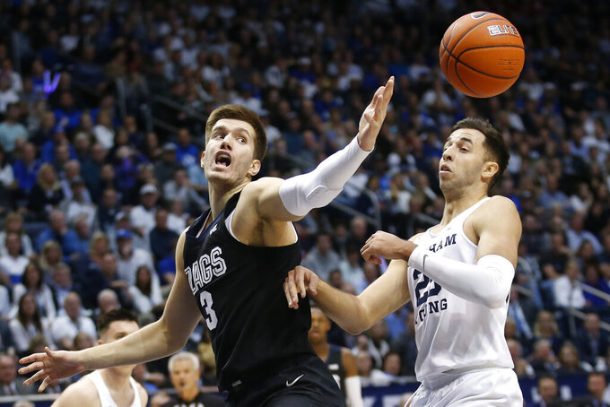 Gonzaga forward Filip Petrusev (3) and BYU forward Gavin Baxter (25) battle for a rebound in the first half during an NCAA college basketball game Saturday, Feb. 22, 2020, in Provo, Utah. (AP Photo/Rick Bowmer)