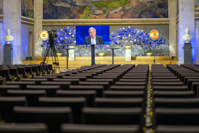 UN Secretary-General Antonio Guterres speaks to empty seats in the University Hall, during the digital broadcast of the Nobel Peace Prize Forum in Oslo, Friday, Dec. 11, 2020. (Heiko Junge/NTB via AP)
