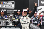 AJ Allmendinger celebrates after winning the NASCAR Series auto race at Indianapolis Motor Speedway, Sunday, Aug. 15, 2021, in Indianapolis. (AP Photo/Darron Cummings)