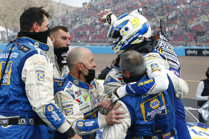Chase Elliott (9) celebrates with his pit crew following his season championship victory in the NASCAR Cup Series auto race at Phoenix Raceway, Sunday, Nov. 8, 2020, in Avondale, Ariz. (AP Photo/Ralph Freso)