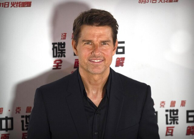 FILE - In this Aug. 29, 2018 file photo, Tom Cruise poses for photos during a red carpet event for the movie