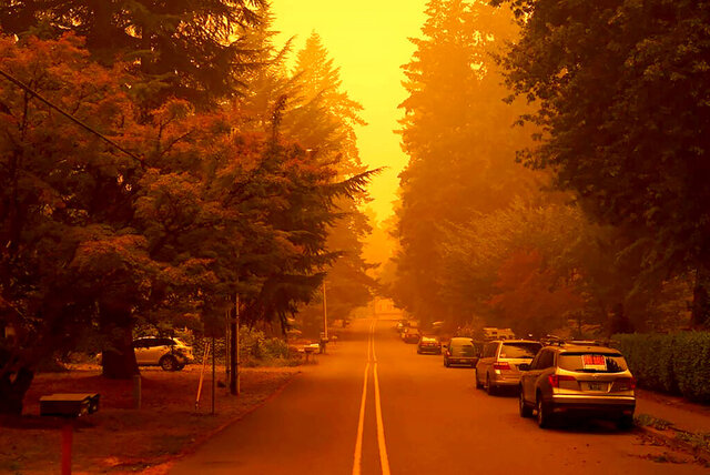 In a photo provided by Christian Gallagher, a street in West Linn, Ore., is shrouded by smoke from wildfires, Thursday, Sept. 10, 2020. (Christian Gallagher via AP)