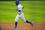 Los Angeles Dodgers' Chris Taylor runs the bases on a solo home run off Colorado Rockies starting pitcher Chi Chi Gonzalez during the fourth inning of a baseball game Saturday, Sept. 19, 2020, in Denver. (AP Photo/David Zalubowski)