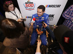 Kyle Larson answers questions during an interview at NASCAR Daytona 500 auto racing media day at Daytona International Speedway, Wednesday, Feb. 13, 2019, in Daytona Beach, Fla. (AP Photo/John Raoux)