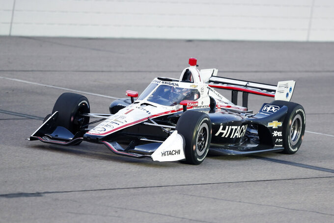 Josef Newgarden races his car during the IndyCar Series auto race Friday, July 17, 2020, at Iowa Speedway in Newton, Iowa. (AP Photo/Charlie Neibergall)