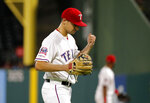 Texas Rangers starting pitcher Brock Burke pounds his glove with his fist after getting Los Angeles Angels' Albert Pujols to fly out to right for the final out in the top of the sixth inning of a baseball game in Arlington, Texas, Tuesday, Aug. 20, 2019. Burke made his major league debut in the game. (AP Photo/Tony Gutierrez)