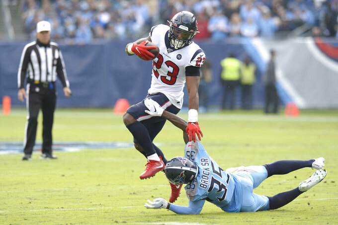 Houston Texans running back Carlos Hyde (23) tries to get past Tennessee Titans cornerback Tramaine Brock Sr. in the first half of an NFL football game Sunday, Dec. 15, 2019, in Nashville, Tenn. (AP Photo/Mark Zaleski)