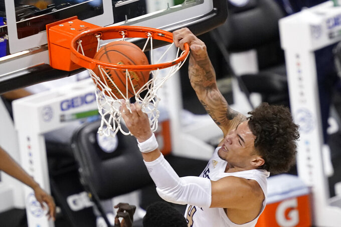 Georgia Tech guard Jordan Usher (4) slams home a dunk during the second half of an NCAA college basketball game against Miami in the quarterfinal round of the Atlantic Coast Conference tournament in Greensboro, N.C., Thursday, March 11, 2021. (AP Photo/Gerry Broome)