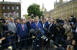 FILE - In this Friday, June 24, 2016 file photo Nigel Farage, the leader of the UK Independence Party speaks to the media on College Green with the Houses of Parliament in the background in London after Britain voted to leave the EU. Britain's love-hate relationship with the rest of Europe goes back decades, but the Brexit crisis gripping it today stems from dramatic January 2013 speech by Prime Minister David Cameron in which he promised an