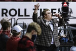 Alabama fans cheer against Kentucky during the second half of an NCAA college basketball game, Tuesday, Jan. 26, 2021, in Tuscaloosa, Ala. (AP Photo/Vasha Hunt)