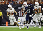 Texas quarterback Sam Ehlinger (11) runs as Rice defensive lineman Myles Adams (99) pursues during the first half of an NCAA college football game Saturday, Sept. 14, 2019, in Houston. (AP Photo/Eric Gay)