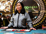 In this March 9, 2016, photo Hat Nguyen, a dealer at the Tropicana casino in Atlantic City N.J., waits for customers at the cash wheel game. On Monday April 16, 2018, Carl Icahn sold the real estate assets of Tropicana Entertainment to Gaming and Leisure Properties, and its casino operations to Eldorado Resorts in a $1.85 billion deal. Tropicana's casino in Aruba is not part of the deal. (AP Photo/Wayne Parry)