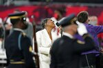 Eric Church, right, and Jazmine Sullivan perform the national anthem before the NFL Super Bowl 55 football game between the Kansas City Chiefs and Tampa Bay Buccaneers, Sunday, Feb. 7, 2021, in Tampa, Fla. (AP Photo/Lynne Sladky)