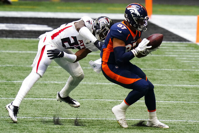 Denver Broncos tight end Noah Fant (87) makes the catch behind Atlanta Falcons strong safety Damontae Kazee (27) during the first half of an NFL football game, Sunday, Nov. 8, 2020, in Atlanta. (AP Photo/Brynn Anderson)