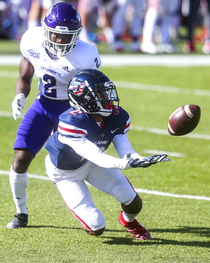 Liberty wide receiver Kevin Shea (2) hauls in a pass as he is defended by Western Carolina cornerback Aaron Gethers (2) during the first half of an NCAA football game on Saturday, Nov. 14, 2020, in Lynchburg, Va. (AP Photo/Shaban Athuman)
