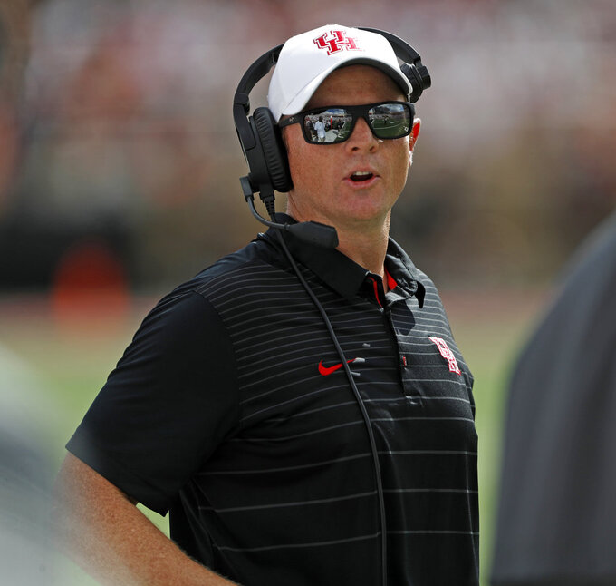 Houston coach Major Applewhite talks to his assistants during an NCAA college football game against Texas Tech, Saturday, Sept. 15, 2018, in Lubbock, Texas. (Brad Tollefson/Lubbock Avalanche-Journal via AP)