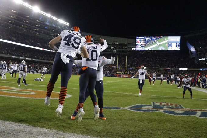 Chicago Bears quarterback Mitchell Trubisky (10) celebrates with teammates after Trubisky ran for a touchdown during the second half of an NFL football game against the Dallas Cowboys, Thursday, Dec. 5, 2019, in Chicago. (AP Photo/Morry Gash)