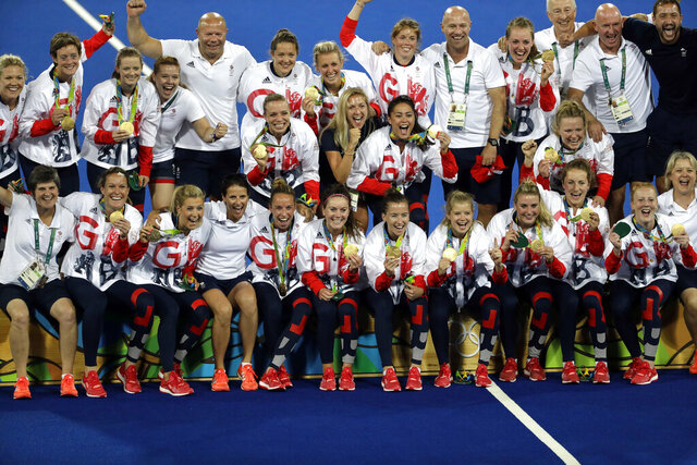FILE - In this Friday, Aug. 19, 2016 file photo, players from Britain pose with their gold medals following the medals ceremony for the women's field hockey competition at 2016 Summer Olympics in Rio de Janeiro, Brazil. Britain are playing in the 2020 FIH Pro League competition as main preparation for defending their titles in Tokyo. (AP Photo/Hussein Malla, file)