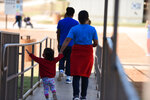 "This Thursday, Aug. 9, 2018, photo, provided by U.S. Immigration and Customs Enforcement, shows a scene from a tour of South Texas Family Residential Center in Dilley, Texas. Currently housing 1,520 mothers and their children, about 10 percent are families who were temporarily separated and then reunited under a ""zero tolerance policy"" that has since been reversed. (Charles Reed/U.S. Immigration and Customs Enforcement via AP)"