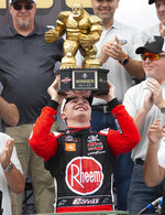 Christopher Bell celebrates in Victory Lane after winning the NASCAR Xfinity Series, Saturday, May 4, 2019, at Dover International Speedway in Dover, Del. (AP Photo/Jason Minto)