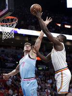 Golden State Warriors forward Eric Paschall, right, is fouled by Miami Heat forward Meyers Leonard (0) during the first half of an NBA basketball game, Friday, Nov. 29, 2019, in Miami. (AP Photo/Lynne Sladky)
