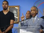 Eric Garner Jr., left, the son of chokehold victim Eric Garner, listens as Rev. Al Sharpton, right, founder of the National Action Network (NAN), speak during a news conference after NYPD Commissioner James O'Neill announced his decision to fire NYPD officer Daniel Pantaleo for the 2014 death of Eric Garner, Monday Aug. 19, 2019, at NAN headquarters in New York. ( AP Photo/Bebeto Matthews)