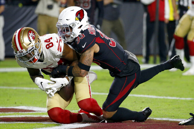San Francisco 49ers wide receiver Kendrick Bourne (84) pulls in a touchdown pass as Arizona Cardinals cornerback Byron Murphy (33) defends during the first half of an NFL football game, Thursday, Oct. 31, 2019, in Glendale, Ariz. (AP Photo/Ross D. Franklin)