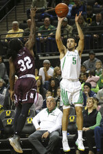 Oregon's Chris Duarte, right, shots a 3-pointer over Texas Southern's Divonte Lumpkin during the first half of an NCAA college basketball game in Eugene, Ore., Saturday, Dec. 21, 2019. (AP Photo/Chris Pietsch)