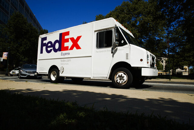 FILE - In this June 26, 2019, file photo a FedEx truck drives in Philadelphia. Amazon said it will allow its third-party sellers to start using FedEx's ground service again after banning them from using it for about a month during the busy holiday shopping season because FedEx purportedly wasn't delivering on time. (AP Photo/Matt Rourke, File)