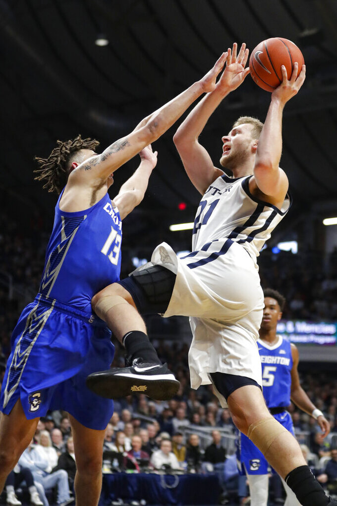 Butler center Derrik Smits (21) shoots over Creighton forward Christian Bishop (13) in the first half of an NCAA college basketball game in Indianapolis, Saturday, Jan. 4, 2020. (AP Photo/Michael Conroy)