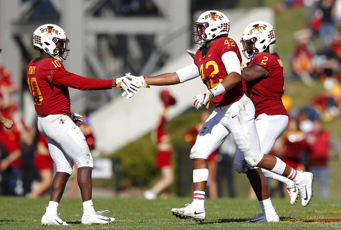 Iowa State linebacker Marcel Spears Jr. (42) celebrates with teammate Brian Peavy (10) after intercepting a pass during the second half of an NCAA college football game against Texas Tech, Saturday, Oct. 27, 2018, in Ames, Iowa. (AP Photo/Charlie Neibergall)