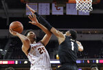 Southern California forward Bennie Boatwright, left, shoots as Colorado guard Tyler Bey defends during the first half of an NCAA college basketball game Saturday, Feb. 9, 2019, in Los Angeles. (AP Photo/Mark J. Terrill)