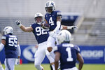 BYU defensive back Troy Warner (4) celebrates his interception with Tyler Batty (92) in the first half during an NCAA college football game against UTSA, Saturday, Oct. 10, 2020, in Provo, Utah. (AP Photo/Rick Bowmer, Pool)