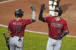 Arizona Diamondbacks' Carson Kelly (18) is greeted by Josh Rojas after hitting a solo home run against the Pittsburgh Pirates during the seventh inning of a baseball game, Wednesday, Aug. 25, 2021, in Pittsburgh. (AP Photo/Keith Srakocic)