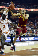 Iowa State guard Talen Horton-Tucker (11) drives to the basket past Texas guard Courtney Ramey (3) during the first half of an NCAA college basketball game, Saturday, March 2, 2019, in Austin, Texas. (AP Photo/Eric Gay)