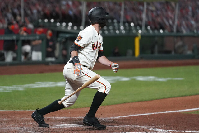 San Francisco Giants' Brandon Belt watches his two-run double against the Colorado Rockies during the seventh inning of a baseball game in San Francisco, Tuesday, Sept. 22, 2020. (AP Photo/Jeff Chiu)
