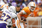 Tennessee quarterback Harrison Bailey (15) runs for yardage during the second half of an NCAA college football game against Tennessee Tech, Saturday, Sept. 18, 2021, in Knoxville, Tenn. Tennessee won 56-0. (AP Photo/Wade Payne)