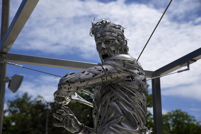 A statue of Spanish artist Jordi Diez representing Spain's Rafael Nadal is seen at the Roland Garros stadium, in Paris, Friday, May 28, 2021. (AP Photo/Christophe Ena)