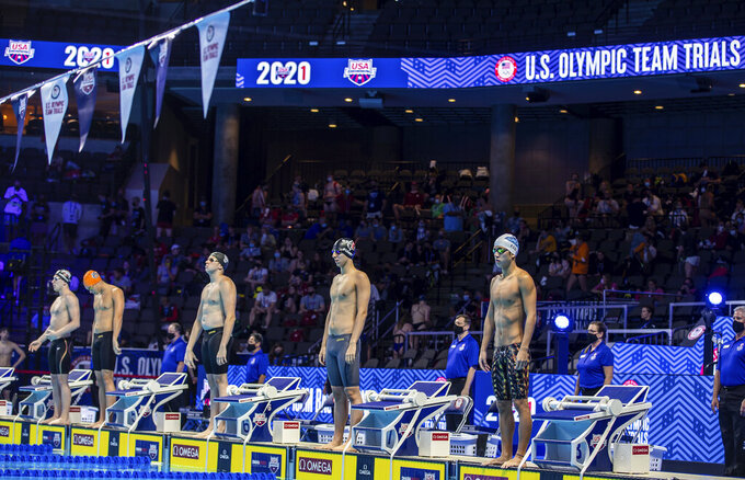 Swimmers line up to competes in the 100-meter backstroke during wave 1 of the U.S. Olympic Swim Trials on Friday, June 4, 2021, in Omaha, Neb. (Chris Machian/Omaha World-Herald via AP)