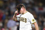 San Diego Padres relief pitcher Mark Melancon reacts after being removed in the ninth inning of the team's baseball game against the Cincinnati Reds on Thursday, June 17, 2021, in San Diego. (AP Photo/Derrick Tuskan)
