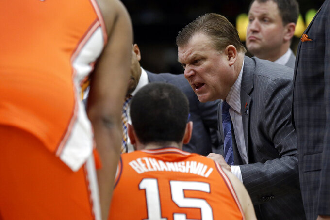 Illinois head coach Brad Underwood was alls to his team during the second half of an NCAA college basketball game against the Iowa in the second round of the Big Ten Conference tournament, Thursday, March 14, 2019, in Chicago. (AP Photo/Kiichiro Sato)