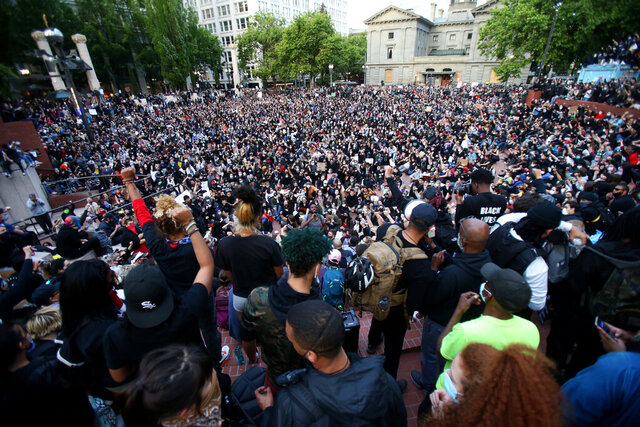 A crowd gather in Pioneer Square in downtown Portland by dusk on Tuesday, June 2, 2020 as protests continued for a sixth night in Portland, demonstrating against the death of George Floyd. Floyd died after being restrained by Minneapolis police officers on May 25.(Sean Meagher/The Oregonian via AP)