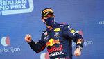 Red Bull driver Sergio Perez of Mexico celebrates on the podium after winning the Formula One Grand Prix at the Baku Formula One city circuit in Baku, Azerbaijan, Sunday, June 6, 2021. (Maxim Shemetov, Pool via AP)