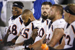 Denver Broncos offensive tackle Elijah Wilkinson (68), offensive guard Ronald Leary (65) and others sit on the bench during the second half of an NFL football game against the Oakland Raiders Monday, Sept. 9, 2019, in Oakland, Calif. Oakland won the game 24-16. (AP Photo/Ben Margot)